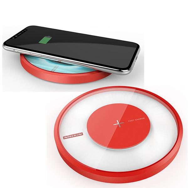 Быстрая беспроводная зарядка + лампа Nillkin Magic Disk 4 КраснаяЗарядные устройства<br>Быстрая беспроводная зарядка + лампа Nillkin Magic Disk 4 Красная.         СТИЛЬНАЯ И КАЧЕТВЕННАЯMagic Disc 4 от Nillkin - яркий пример инновационного продукта на стыке технологий и дизайна. Устройство выполнено в форме футуристического круга с стильной подсветкой из матового поликарбоната с покрытием soft touch и закаленного стекла          БЕСПРОВОДНАЯ  Magis Disc 4 - это новое поколение беспроводных зарядных станций, работающих по стандарту Qi c эффективностью более 80%. Всё, что вам потребуется для зарядки - положить смартфон сверху               БЫСТРАЯ И БЕЗОПАСНАЯУстройство оснащено технологией быстрой зарядки, благодаря чему ваш смартфон зарядится на 40% быстрее обыкновенной беспроводной заредки, сэкономив драгоценное время. Интеллектуальная начинка автоматически определит, если на станцию случайным образом попадет не смартфон, а металлический предмет, например ключи, и прекратит индукционный процесс, воспряпятствуя нагреву и возгоранию. Кроме того электроника защитит от скачков напряжения, перегрева, перезарядки и тругих угроз. После полной подзарядки смартфона, станция автоматически прекращает процесс зарядки                     ЛАМПА-НОЧНИК С 16 МИЛЛИОНАМИ ЦВЕТОВ  Помимо основной функции - беспроводной Qi зарядки, Magic Disc 4 имеет встроенную лампу-ночник с приятным мягким светом и 16 миллионами цветов. Вы не только будете видеть на какой стадии ваша зарядка смартфона, в зависимости от цвета, но и сможете задавать собственный, используя устройство в качестве ночника или стильного элемента интерьера, задающего настроение в комнате            ИДЕАЛЬНО ДЛЯ НОВЫХ IPHONEПомимо совместимости со всеми смартфонами, поддерживающими беспроводную Qi зарядку, Nillkin Magic Disc 4 идельно подойдет новым iPhone от Apple как по функционалу, так и по дизайну                ХАРАКТЕРИСТИКИ     стандарт зарядки: Qi   дистанция подзарядки: ?6мм   габариты: 110*110*16.5мм   эффективность: