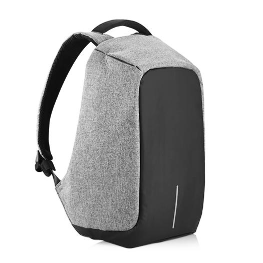 Рюкзак XD Design Bobby anti-theft backpack СерыйРюкзаки<br>Что это?Жить в современном мегаполисе – жить в постоянном движении. Каждый день мы смешиваемся с толпой в автобусе, метро, на улице спеша на работу, учебу, в гости к бабушке. И каждый день мы рискуем стать одним из сорока тысяч жертв карманной кражи           Рюкзак Bobby – проект родом с Kickstarter'a от XD Design, объединяющий в себе стиль, безопасность и удобство использования. Аскетичный, на первый взгляд, портфель оборудован USB-разъемом для подзарядки смартфона, множеством потайных кармашков, светотражающими полосками, анатомичной формой для правильного распределения веса и, самое главное, защитой от грабителей. Специально для тех, кто часто путешествует, предусмотрено удобное крепление на чемодан                 Защита от кражиДизайнеры заявляют, что идея создания Bobby появилась после посещения Шанхая. В переполненном городе туристы, опасаясь кражи, носили свои портфели задом наперед. За счет своего уникального дизайна, Bobby похож на стильный мешок – на нем нет ни одной видимой молнии. Для того, что добраться к содержимому необходимо подвернуть края рюкзака, за которыми спрятана оригинальная застежка YKK             Рюкзак, в зависимости от потребности, открывается под тремя углами. Для быстрого доступа в общественном транспорте или на ходу достаточно приоткрыть его на 30 градусов, а для полной загрузки или разгрузки содержимого - на 90 и даже 180 градусов                    Всё под рукойДля удобного пользования в общественных местах предусмотрено множество потайных мелких карманчиков для быстрого доступа к содержимому сумки. Кармашки в лямках подойдут для хранения мелочи, кредитных карт или ключей. Еще один незаметный карман на спинке и два боковых отделения на «крыльях» для самого ценного в поездке – документов или смартфона                 Защита от порезовДля защиты от воров с колюще-режущими предметами, создатели оборудовали рюкзак прослойкой из пяти разных материалов. Внешний слой – приятная и